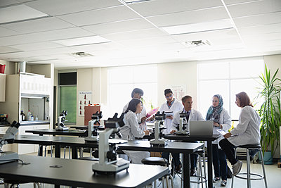 Professor and college students in science laboratory - p1192m1145703 by Hero Images
