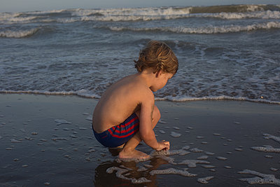 Kid at the beach - p1308m2126695 by felice douglas
