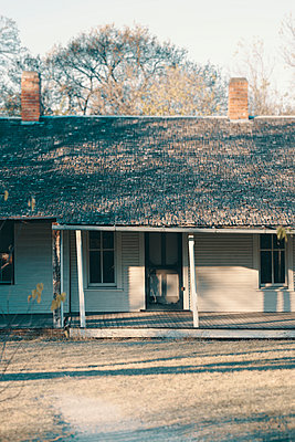Abandoned Ranch House with a Porch and Two Chimneys - p1617m2237807 by Barb McKinney