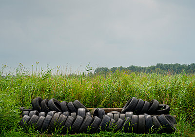 Disused tires - p1132m931839 by Mischa Keijser
