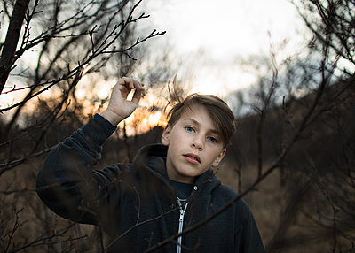 Boy Holding on to Branch - p1503m2015865 by Deb Schwedhelm