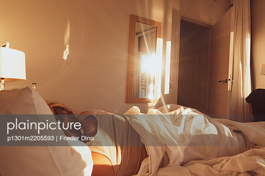 The sun shines through the bedroom - p1301m2205593 by Delia Baum