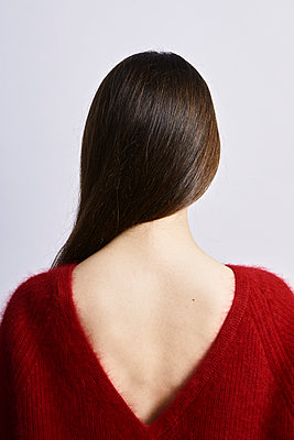 Back of a young woman wearing red sweater - p1540m2157649 by Marie Tercafs