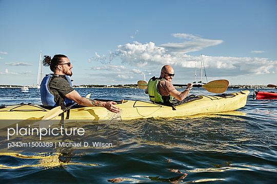 Two men in tandem sea kayak, Portland, Maine, USA