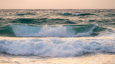 Sea waves at sunset - p1427m2285544 by Tom Grill