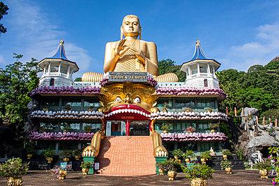 Golden Buddha statue - p1691m2288618 by Roberto Berdini Bokeh