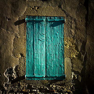 Old green shutters closed. - p813m1000135 by B.Jaubert