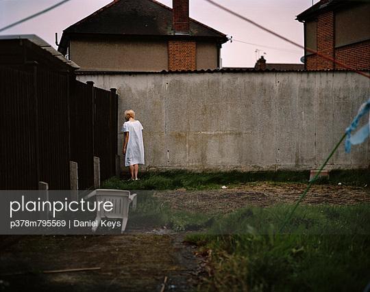 Girl in garden corner - p378m795569 by Daniel Keys
