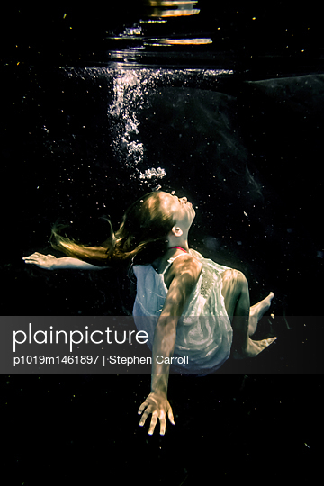 Child floating underwater - p1019m1461897 by Stephen Carroll