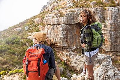Young couple mountain hiking - p1355m1574156 by Tomasrodriguez