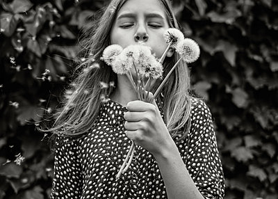 Girl Blowing Dandelions - p1503m2020423 by Deb Schwedhelm