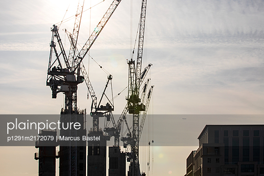 Construction cranes and high rises - p1291m2172079 by Marcus Bastel