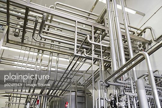 Industrial piping in a factory - p9248943f by Image Source