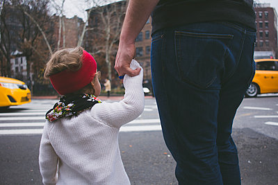 Father and daughter holding hands while crossing road - p1166m1174152 by Cavan Images