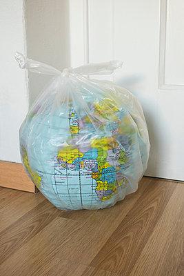 Globe in plastic bag - p1199m2208715 by Claudia Jestremski