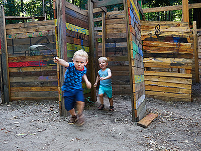 Two children in adventure playground - p358m1138321 by Frank Muckenheim