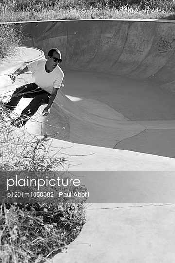 Skate park and Skateboarder - p1201m1050382 by Paul Abbitt