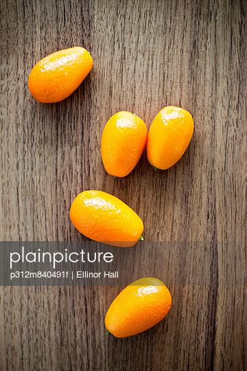Kumquat fruits on wooden table