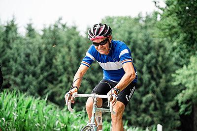 Bicyclist - p1437m2107318 by Achim Bunz