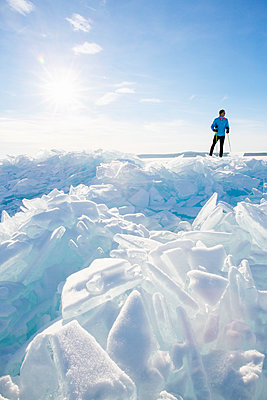 Person standing near blocks of ice - p312m1556905 by Lena Granefelt