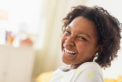 Close up of laughing Black girl - p555m1412291 by JGI/Tom Grill