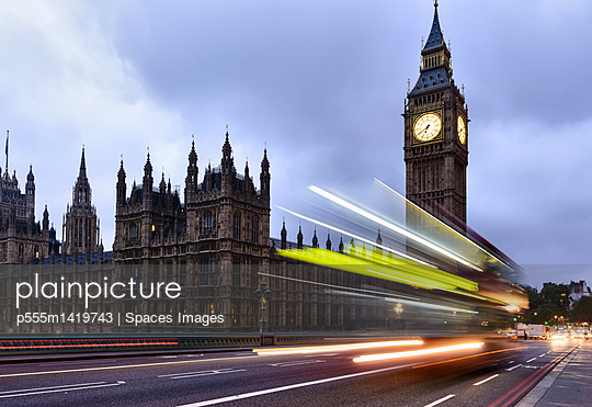 Long exposure of bus passing Houses of Parliament, London, United Kingdom