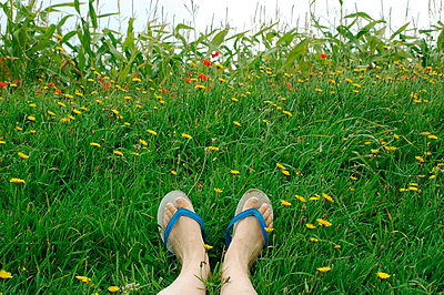 Feet and flip flops - p6810015 by Sandrine Léon