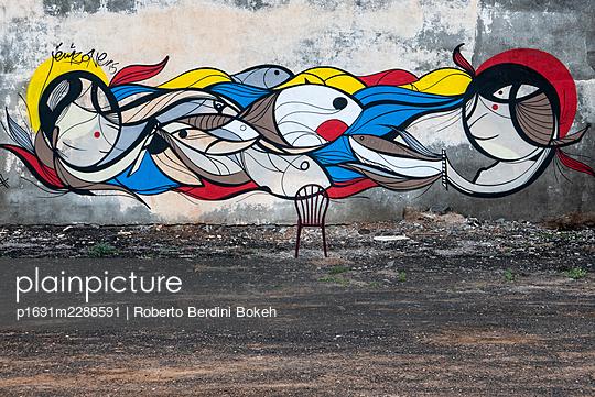 graffiti and rusty chair - p1691m2288591 by Roberto Berdini Bokeh