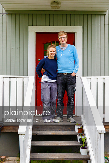 Sweden, Sodermanland, Portrait of young couple standing on porch