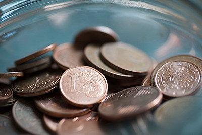 Close-up of Euro cent coins in glass jar - p301m1482418 by Halfdark