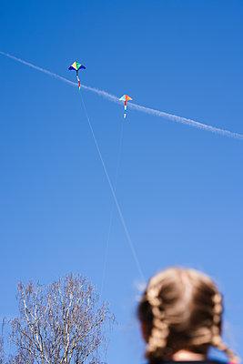 Girl flying kite - p312m2139500 by Anna Johnsson