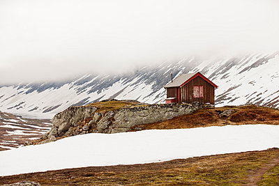 Wooden house in foggy mountains - p575m744067f by Per Eriksson