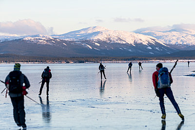 People moving on ice - p312m1114053f by Henrik Trygg
