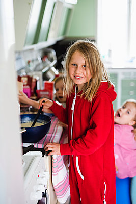 Girl cooking in kitchen - p312m2079801 by Anna Johnsson