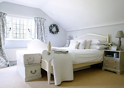Double bed in attic conversion of Forest Row farmhouse - p349m790333 by Brent Darby