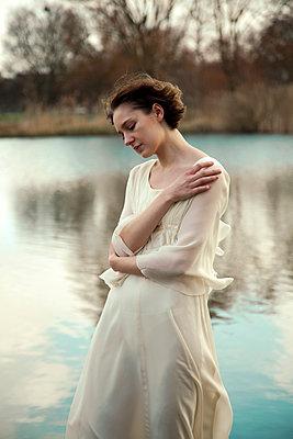 Retro Woman by Lake - p1248m1562051 by miguel sobreira