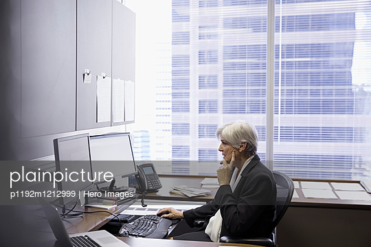 Female lawyer working at computer in office