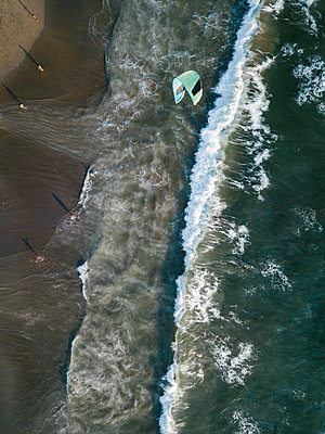 Indonesia, Bali, Berawa beach, Aerial view of kite surfer - p300m2070224 by Konstantin Trubavin