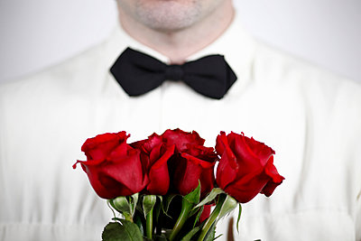 Man with roses - p611m984667 by Laurence Ladougne