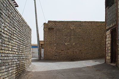 Brickwalls in town  - p798m1044487 by Florian Loebermann