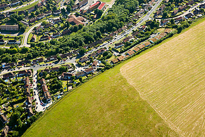 Houses and field - p9249278f by Image Source