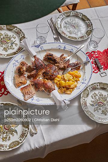 Christmas dinner - p250m2260902 by Christian Diehl