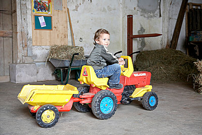 Boy on a toy tractor - p1230m1042620 by tommenz
