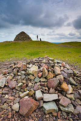 Stone cairns and dogwalker at Dunkery Beacon in Exmoor National Park, Somerset, England, United Kingdom, Europe - p8713138 by Adam Burton