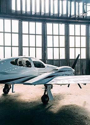 Diamond Propeller Plane in former military Hangar - p1085m1111544 by David Carreno Hansen