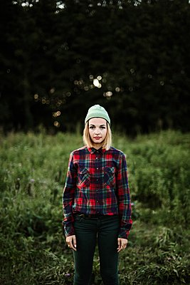 Young beautiful hipster woman standing on field in the countryside - p1166m2096019 by Cavan Images