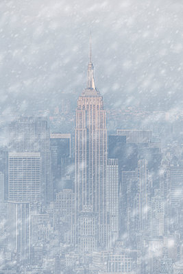 Empire state building in the snow - p1280m1439934 by Dave Wall