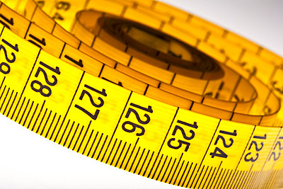 diet - yellow measuring tape isolated on white background - p4551509f by Frank Chmura