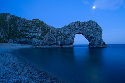 Durdle door in dorset at dusk - p9244167f by Image Source