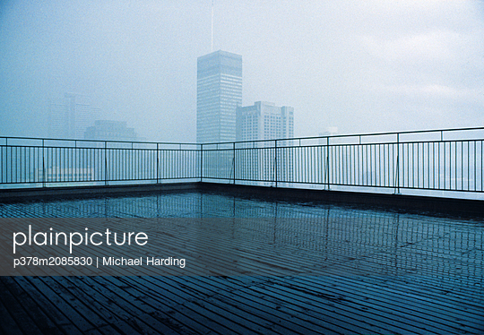 SKYLINE IN RAIN - p378m2085830 by Michael Harding